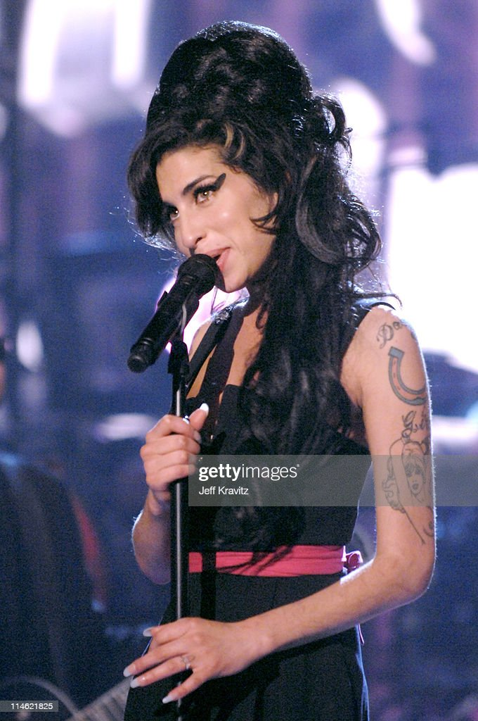 <a gi-track='captionPersonalityLinkClicked' href=/galleries/search?phrase=Amy+Winehouse&family=editorial&specificpeople=201684 ng-click='$event.stopPropagation()'>Amy Winehouse</a> performs 'Rehab' during 2007 MTV Movie Awards - Show at Gibson Amphitheater in Los Angeles, California, United States.