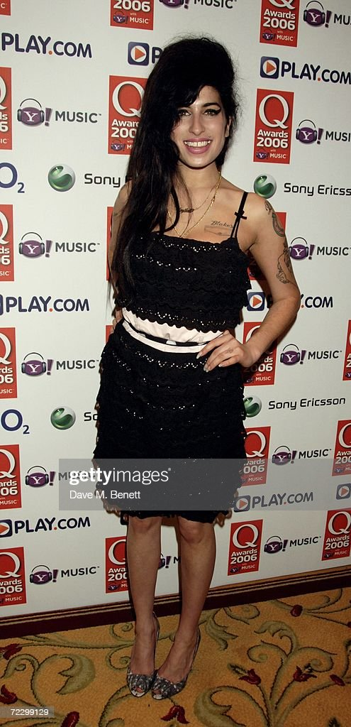 Amy Winehouse poses in the awards room at the Q Awards 2006 the annual magazine's music awards at Grosvenor House on October 30 2006 in London England
