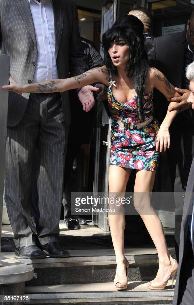 Amy Winehouse slips on the steps as she leaves the City of Westminster Magistrates' Court on March 17 2009 in London England