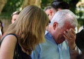 Amy Winehouse's father Mitch Winehouse cries as he looks at the floral tributes outside her Camden Square home on July 25 2011 in London United...