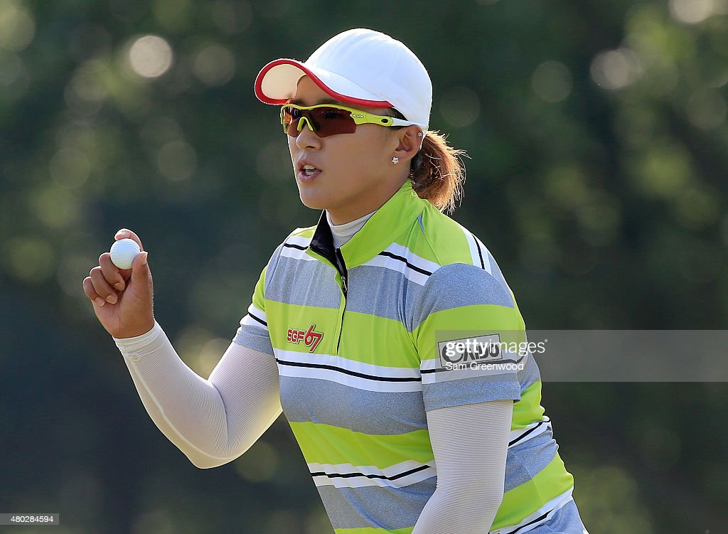 Amy Yang of South Korea acknowledges the crowd on the 15th hole during the second round of the US Women's Open at Lancaster Country Club on July 10...