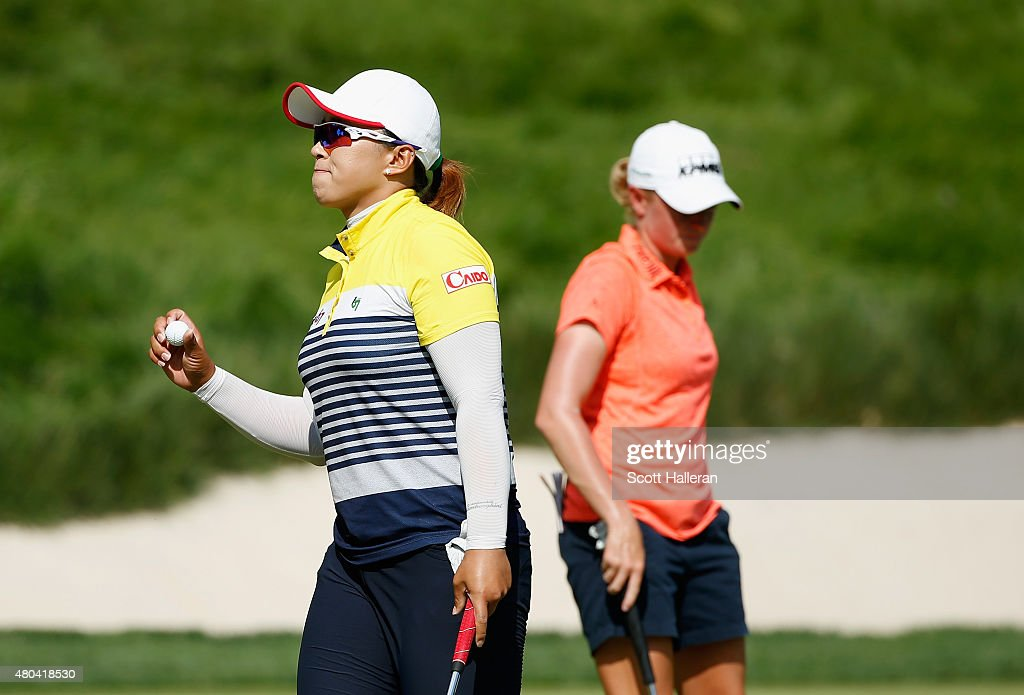 Amy Yang of South Korea and Stacy Lewis of the United States walk across the 12th green during the third round of the US Women's Open at Lancaster...