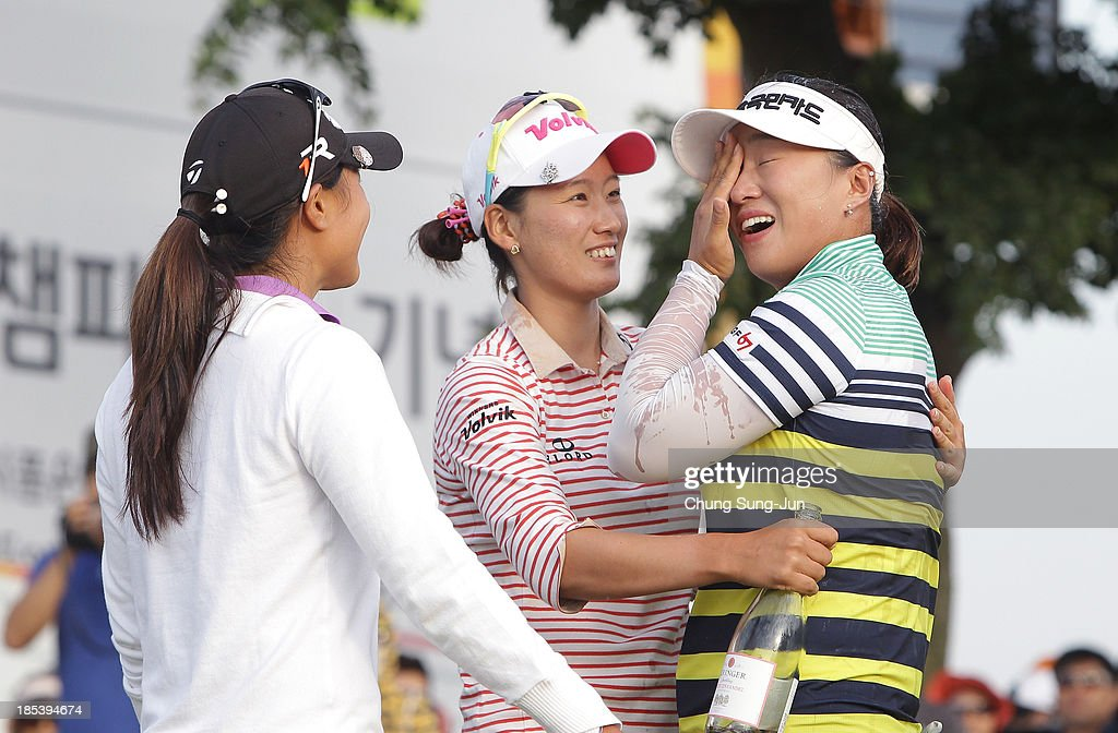<a gi-track='captionPersonalityLinkClicked' href=/galleries/search?phrase=Amy+Yang+-+Golfer&family=editorial&specificpeople=739014 ng-click='$event.stopPropagation()'>Amy Yang</a> of South Korea celebrates with <a gi-track='captionPersonalityLinkClicked' href=/galleries/search?phrase=Chella+Choi&family=editorial&specificpeople=5770500 ng-click='$event.stopPropagation()'>Chella Choi</a> of South Korea after the winning of the LPGA KEB-HanaBank Championship at Sky 72 Golf Club Ocean Course on October 20, 2013 in Incheon, South Korea.