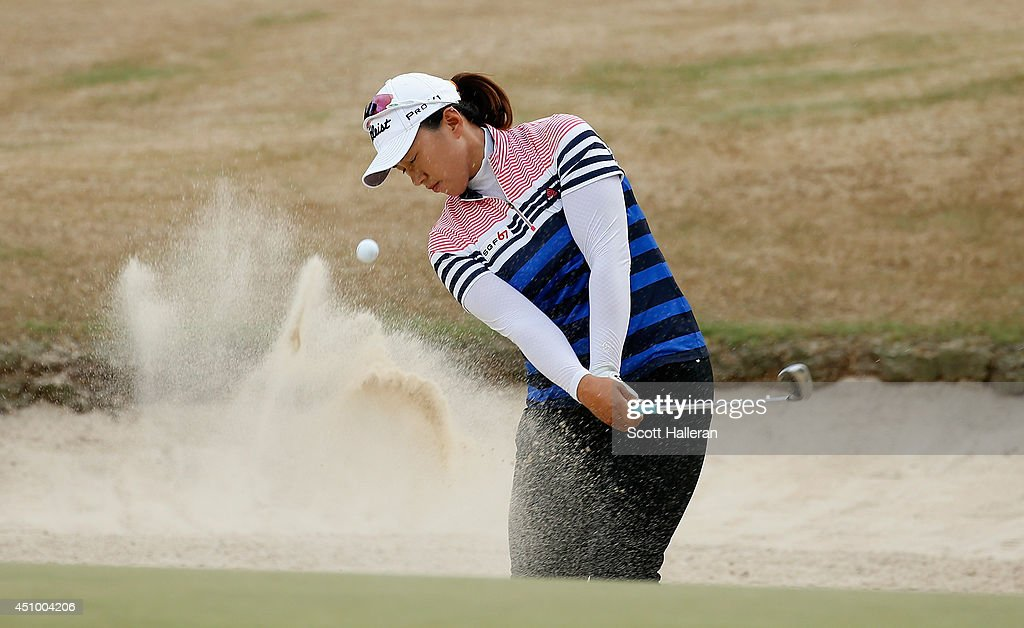 <a gi-track='captionPersonalityLinkClicked' href=/galleries/search?phrase=Amy+Yang&family=editorial&specificpeople=739014 ng-click='$event.stopPropagation()'>Amy Yang</a> of South Korea plays a bunker shot on the 16th hole during the third round of the 69th U.S. Women's Open at Pinehurst Resort & Country Club, Course No. 2 on June 21, 2014 in Pinehurst, North Carolina.