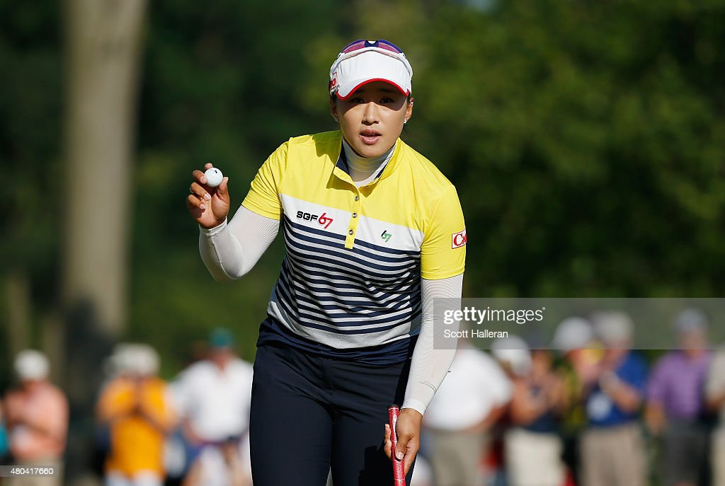 Amy Yang of South Korea waves to the gallery on the 17th green during the third round of the US Women's Open at Lancaster Country Club on July 11...