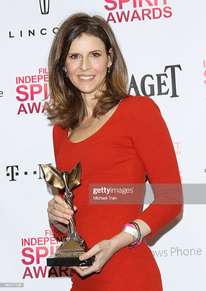 Amy Ziering poses with the Best Documentary award for 'The Invisible War' in the press room during the 2013 Film Independent Spirit Awards held on...
