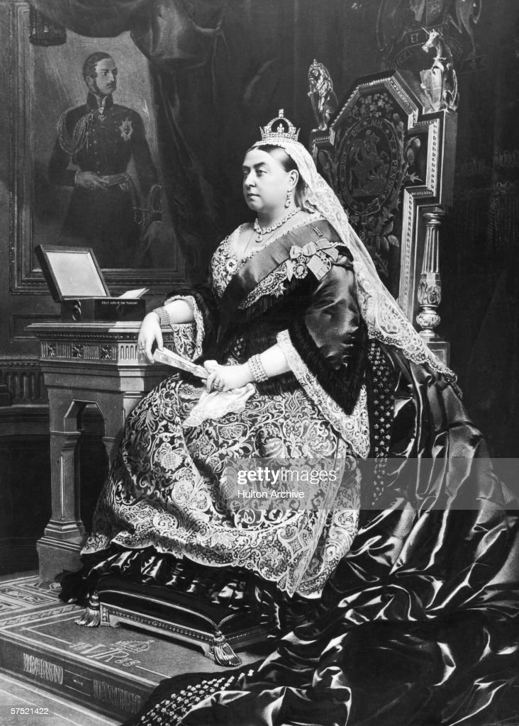 An 1883 painting of Queen Victoria (1819 - 1901), taken from an 1882 photograph by Alexander Bassano. Behind the queen is a portrait of her deceased consort, Prince Albert, by German artist Franz Xaver Winterhalter, and the box beside her is labelled 'First Lord of the Treasury'.