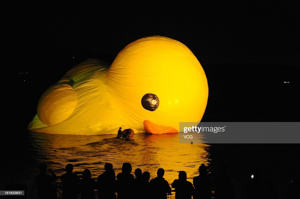 An 18-meter high rubber duck designed by Dutch conceptual artist Florentijn Hofman is on display at the Summer Palace on September 25, 2013 in Beijing, China. The giant, inflatable rubber duck will be in the Summer Palace from September 26 to October 26.