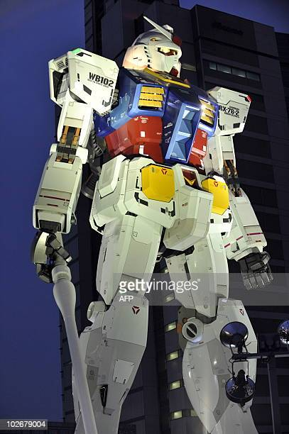 An 18metre tall statue of popular TV animation hero Gundam is lit up at a park in Shizuoka city 150km west of Tokyo on July 6 2010 for a press...