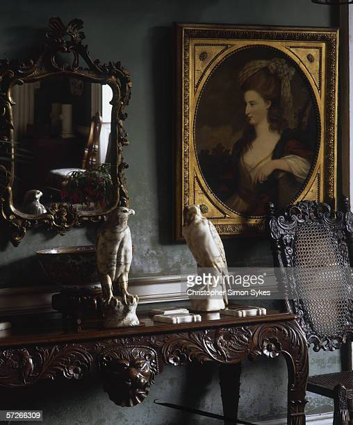 An 18th century Irish table in the hallway of Beaulieu House County Louth circa 2005 The portrait is of Miss Sidney Montgomery whose halfbrother the...