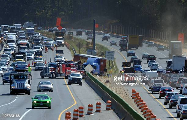 An 18wheel tractor trailer straddles the media after an accident on Beltway 495 just south of Gallows road left traffic snarled on September 21 in...