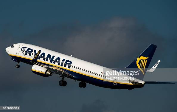 An 737 Boeing plane of the Ryanair company takes off on October 11 2014 at the LilleLesquin airport northern France AFP PHOTO / PHILIPPE HUGUEN