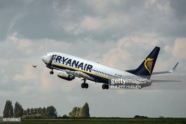 An 737 Boeing plane of the Ryanair company takes off on October 11 2014 at the LilleLesquin airport northern France AFP PHOTO / PHILIPPE HUGUEN / AFP...