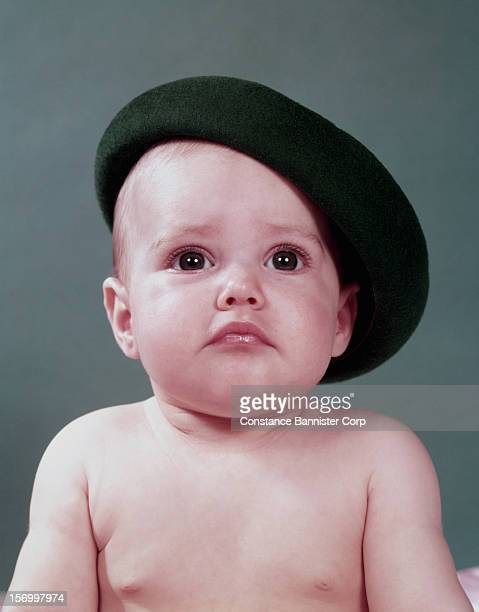 An 8monthold baby wearing a beret 6th November 1952