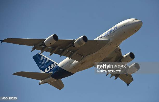 An A380 Airbus airliner overflies the international airport during the XVIII Air and Space Fair in Santiago on March 25 2014 AFP PHOTO/MARTIN BERNETTI