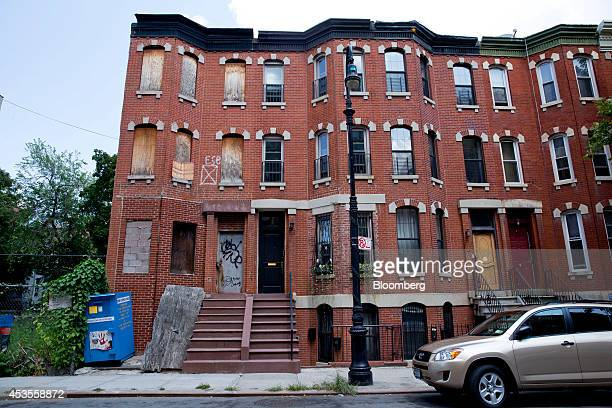 An abandoned brownstone stands in central Harlem New York US on Sunday Aug 10 2014 Developers and buyers are betting Harlem apartment prices which...