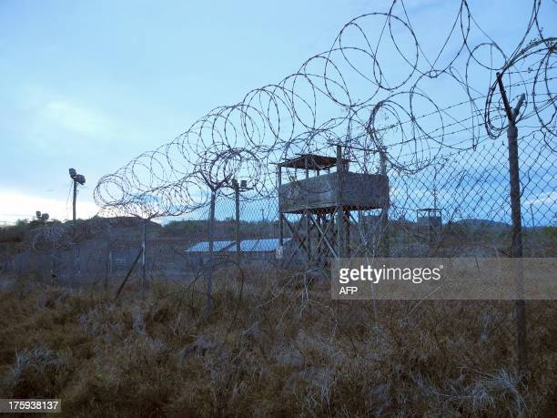 An abandoned camp and tower at the US Naval Base in Guantanamo Bay Cuba on August 8 2013 AFP PHOTO/CHANTAL VALERY