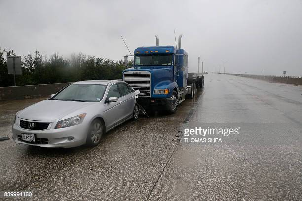 An abandoned car and tractor trailer that were in an accident are seen on Interstate 610 North August 27 2017 in Houston as the city battles with...