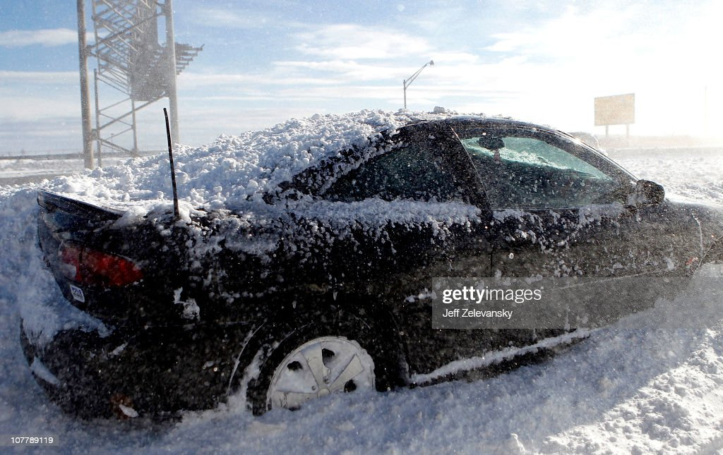 An abandoned car sits on a ramp following a major blizzard that hit the area at Newark Liberty International Airport on December 27 2010 in Newark...