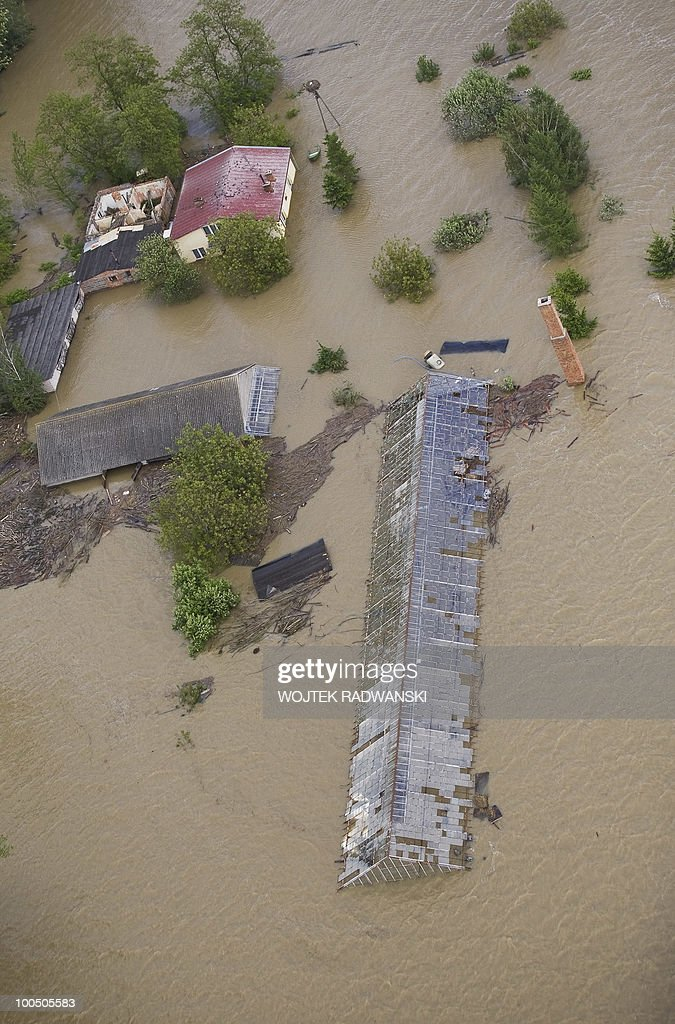 An abandoned farm is in the flooded area of Swiniary village in central Poland at Wisla river on May 25, 2010. Floods caused by torrential rains last week have swollen major Polish rivers to their highest levels in more than a century and have claimed 15 lives.