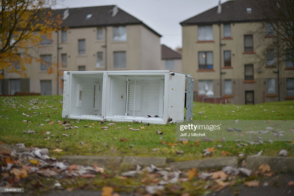 An abandoned fridge near disused housing in the Hamiltonhill area on October 23, 2012 in Glasgow, Scotland. The Scottish National Party (SNP) have announced a welfare fund to provide emergency support to disadvantaged people who are struggling with issues such as unemployment, low income, poor health and lack of educational qualifications.