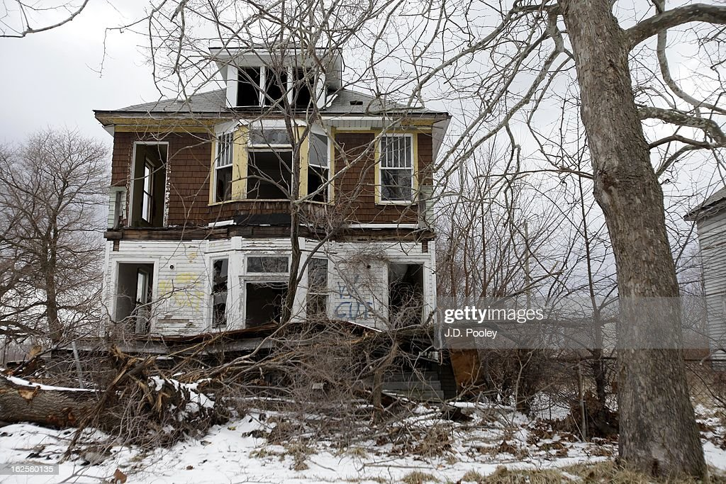 An abandoned home is seen on February 24, 2013 in Detroit, Michigan. The city of Detroit has faced serious economic challenges in the past decade, with a shrinking population and tax base while trying to maintain essential services. A financial review team issued a finding on February 19 identifying the city as being under a 'financial emergency.' Michigan Gov. Rick Snyder has 30 days from the report's issuance to officially declare a financial emergency, which could result in the governor appointing an emergency financial manager to oversee Detroit's municipal government.