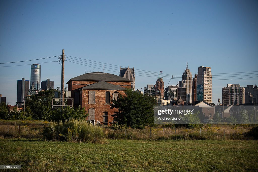 An abandoned home is seen with the Detroit skyline in the background on September 5 2013 in Detroit Michigan Detroit is struggling with over 78000...