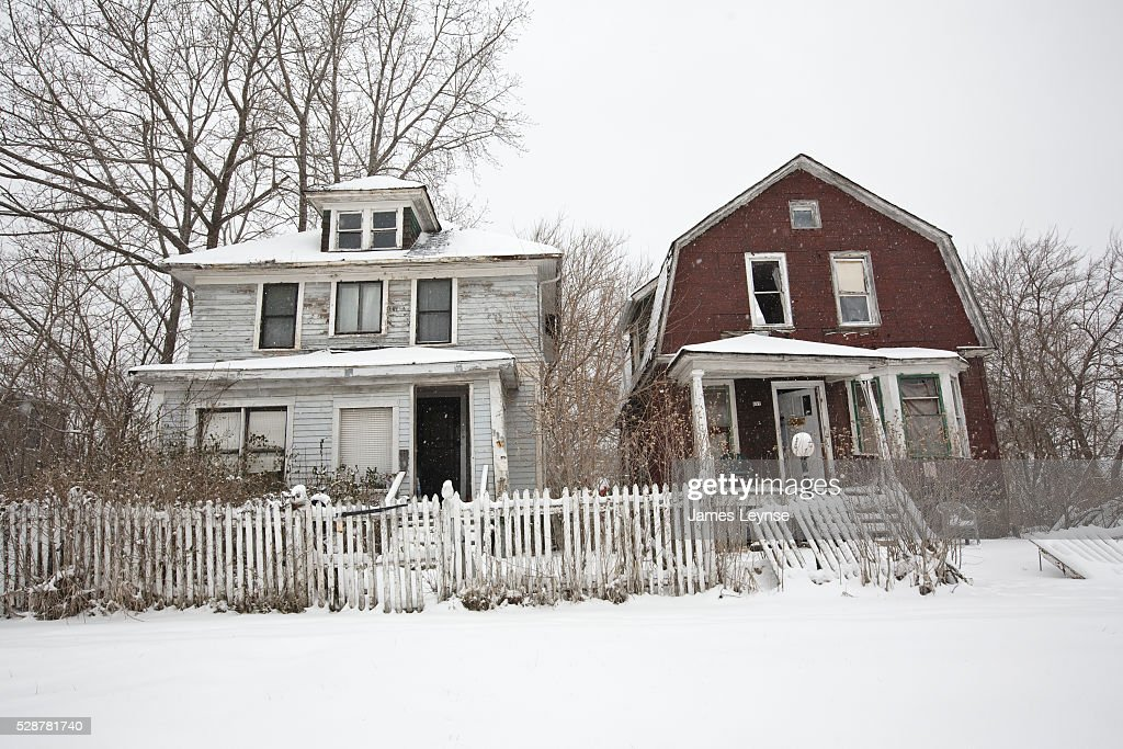 An Abandoned Homes In Highland Park Michigan Is A Suburb Within The