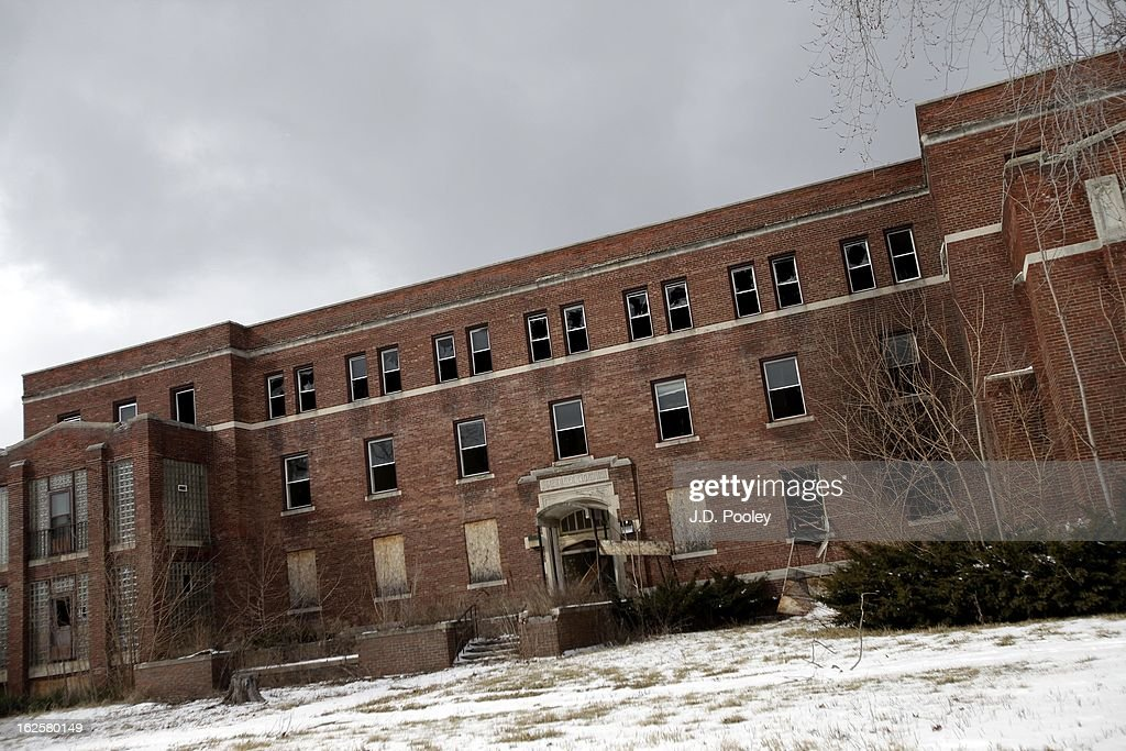 An abandoned hospital is seen February 24, 2013 in Detroit, Michigan. The city of Detroit has faced serious economic challenges in the past decade, with a shrinking population and tax base while trying to maintain essential services. A financial review team issued a finding on February 19 identifying the city as being under a 'financial emergency.' Michigan Gov. Rick Snyder has 30 days from the report's issuance to officially declare a financial emergency, which could result in the governor appointing an emergency financial manager to oversee Detroit's municipal government.