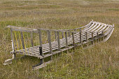 An abandoned Inuit sledge on the island of Shishmaref off the mainland of Alaska September 2004 Global warming has affected this area with disastrous...