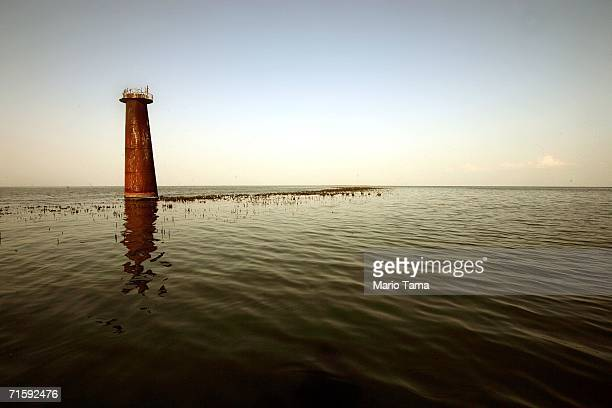 An abandoned lighthouse is seen surrounded by water in the devastated Plaquemine's Parish August 3 2006 near Venice Louisiana Locals say that before...