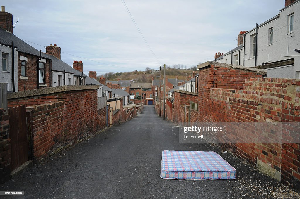 An abandoned mattress in an alleyway between rows of stepped terraced housing in the former pit village of Easington Colliery on April 17, 2013 in Easington, England. Former miners and their families are today holding a commemoration party for the closure of the pit at Easington Colliery; coinciding with the ceremonial funeral for Baroness Thatcher, who took on the mining union during the miners' strike which ultimately led to the closure of the mines and the loss of jobs. Dignitaries from around the world today join Queen Elizabeth II and Prince Philip, Duke of Edinburgh as the United Kingdom pays tribute to former Prime Minster Baroness Thatcher during a Ceremonial funeral with military honours at St Paul's Cathedral. Lady Thatcher, who died last week, was the first British female Prime Minister and served from 1979 to 1990.