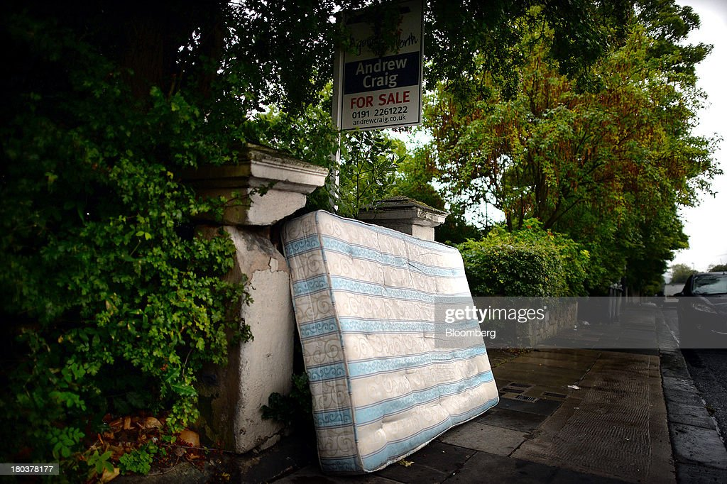 An abandoned mattress leans against a wall outside a residential property advertised for sale in Newcastle-upon-Tyne, U.K., on Wednesday, Sept. 11, 2013. U.K. house prices rose for a seventh month in August and will probably continue to increase through the rest of the year, according to a report by Halifax. Photographer: Nigel Roddis/Bloomberg via Getty Images
