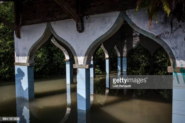 An abandoned mosque which has been surrounded by mangrove caused from rising sea level at Bedono village on June 7 2017 in Demak Indonesia Indonesia...