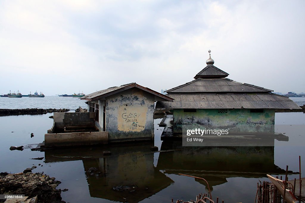 An abandoned mosque which has been surrounded by the encroaching sea sits in the Maura Baru district November 22, 22015 in Jakarta, Indonesia. Jakarta, Southeast Asia's largest city is sinking slowly into the sea, largely due to overconsumption of ground water. Experts say that if nothing is done, the city's northern coast will be inundated with 5-7 meters (15-21 ft.) of seawater by the year 2080. The city has begun shoring up its sea defences as increasing floods and severe storms due to rising temperatures and climate change threaten the mostly poor residents of Jakarta's northern coast with the loss of their homes.