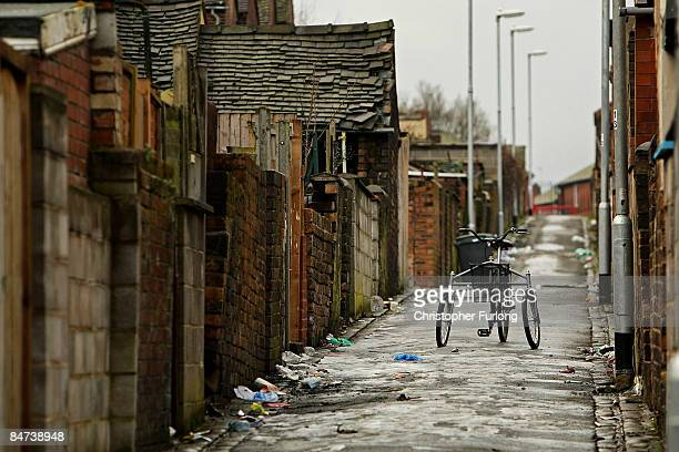 An abandoned tricycle sits in an alleway on February 11 2009 in StokeonTrent England Official Government figures released today show that UK...