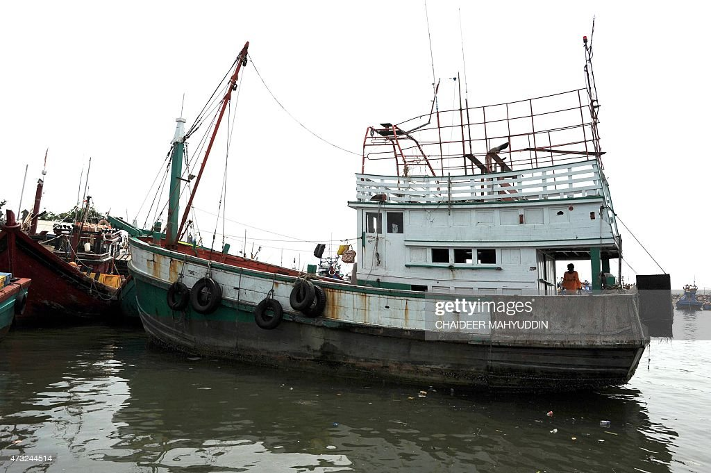 An abandoned wooden fishing boat used to transport nearly for Used fishing boats