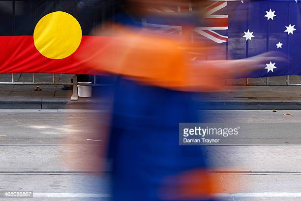 An Aboriginal and an Australian flag as seen during the Austtalia Day Parde on January 26 2014 in Melbourne Australia
