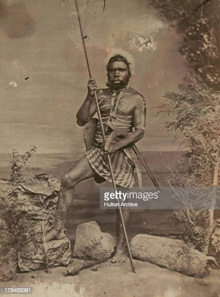 An Aboriginal Australian hunter in body paint poses Australia circa 1880