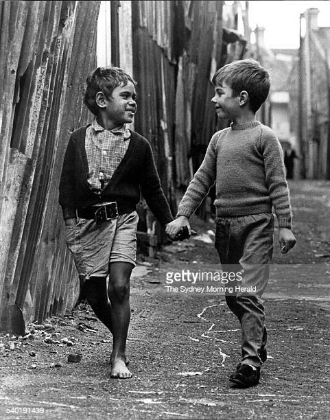 An Aboriginal boy and a white boy playing together in an inner city street of Sydney and holding hands on 25 May 1967 SMH NEWS Picture by GEORGE...