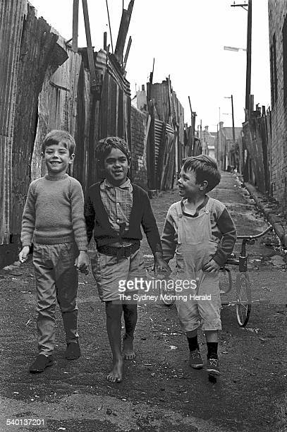 An Aboriginal boy Victor Hookey centre plays with his white friends including Mark Anthony left in a Redfern laneway in the days before the 1967...