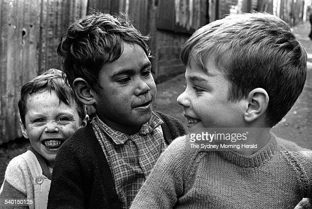 An Aboriginal boy Victor Hookey centre plays with his white friends including Mark Anthony right in a Redfern laneway in the days before the 1967...
