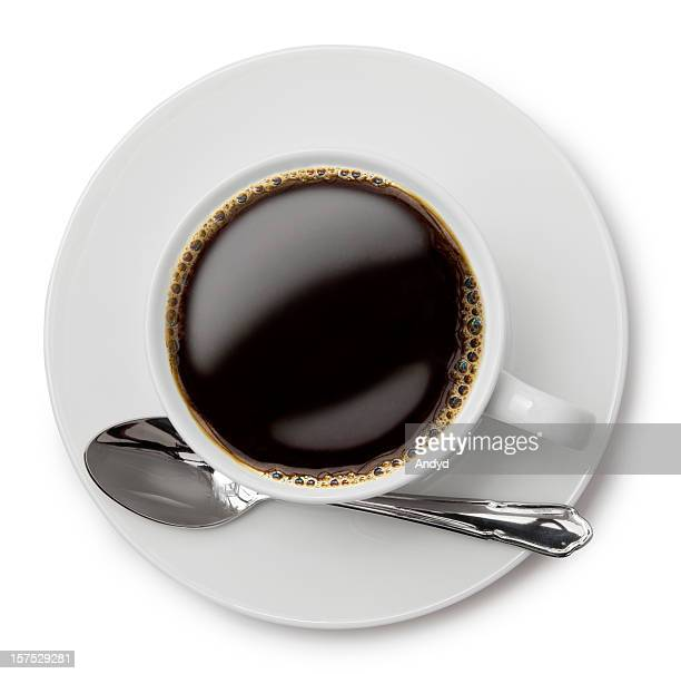 An above shot of black coffee in a white cup
