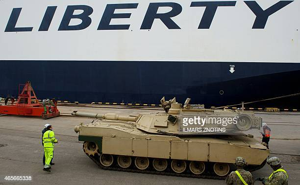 COLLIER An Abrams tank is seen during delivery in the port of Riga on March 9 2015 The US delivered over 100 pieces of military equipment to...