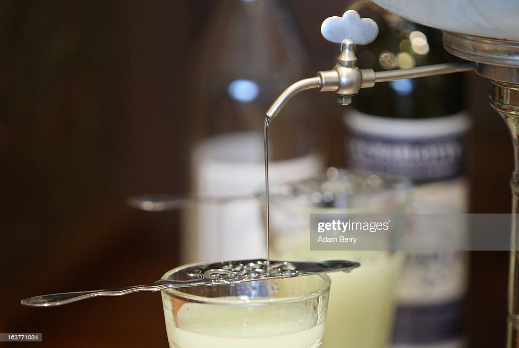 An absinthe fountain pours water into a glass of absinthe on March 15 2013 in Berlin Germany The highly alcoholic drink absinthe was banned in much...