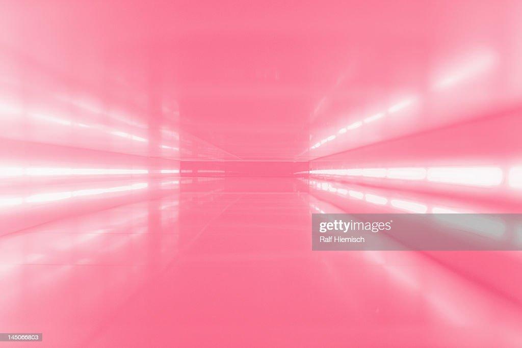 An abstract corridor in pink tones