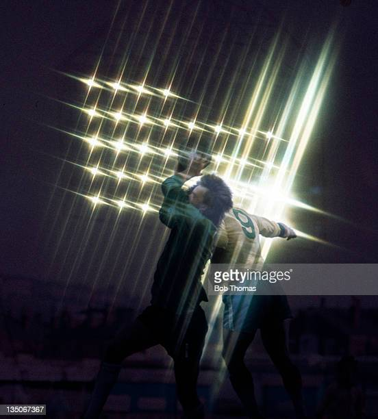 An abstract image of a goalkeeper being challenged as they jump in the glare of the floodlights circa 1975 A starburst filter was used to achieve...