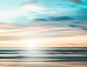 An abstract seascape with blurred panning motion with cross-processed colors background