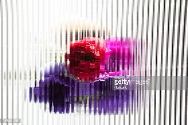 An abstract view of oriental poppies behind beveled glass
