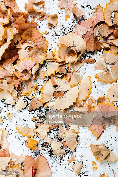 An abundance of pencil shavings and lead on a white background